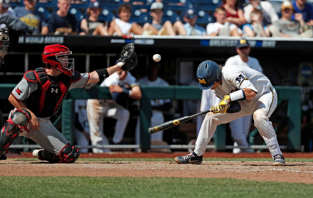 Michigan's Joe Donovan (0) ducks from the pitch during the College World Series game against Texas Tech, Friday, June 21, 2019, at TD Ameritrade Park in Omaha, Neb. [Brad Tollefson/A-J Media]