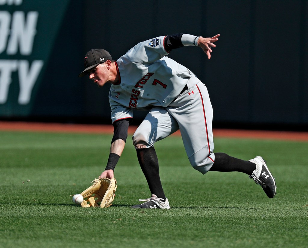 Texas Tech's Cody Masters (7) fields a ground ball during the College World Series game against Michigan, Friday, June 21, 2019, at TD Ameritrade Park in Omaha, Neb. [Brad Tollefson/A-J Media]