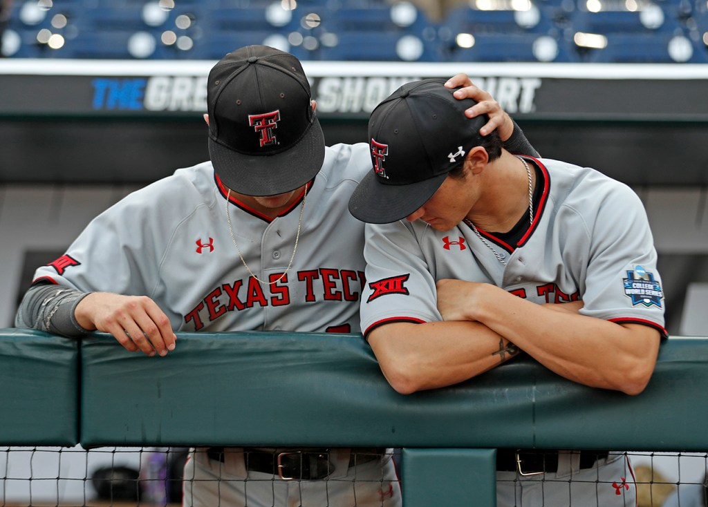 Texas Tech's Kurt Wilson (8) and Bryce Bonnin (40) sit in the dugout after the College World Series game against Michigan, Friday, June 21, 2019, at TD Ameritrade Park in Omaha, Neb. [Brad Tollefson/A-J Media]
