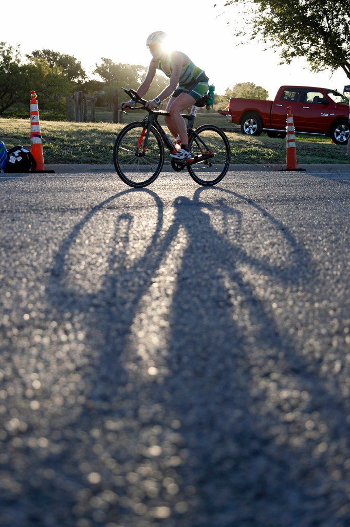 Michaela Jansen, from Lubbock, rides her bike during the Ironman 70.3 Lubbock, Sunday, June 30, 2019, at Dunbar Lake in Lubbock, Texas. [Brad Tollefson/A-J Media]