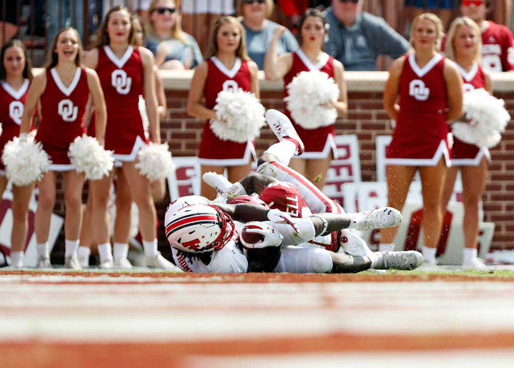 Oklahoma's Delarrin Turner-Yell (32) tackles Texas Tech's SaRodorick Thompson (28) before the end zone during the game Saturday, Sept. 28, 2019, at Gaylord Memorial Stadium in Norman, Okla. [Brad Tollefson/A-J Media]