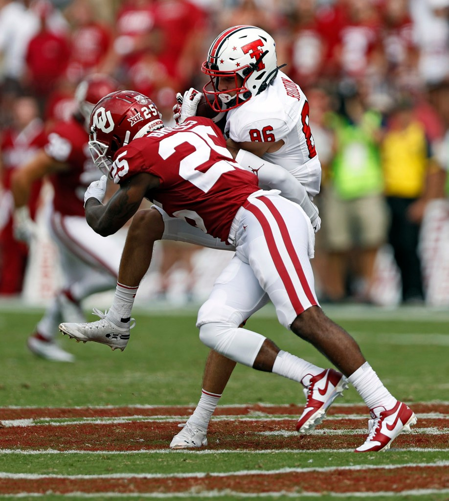 Oklahoma's Justin Broiles (25) tackles Texas Tech's Dalton Rigdon (86) during the game Saturday, Sept. 28, 2019, at Gaylord Memorial Stadium in Norman, Okla. [Brad Tollefson/A-J Media]