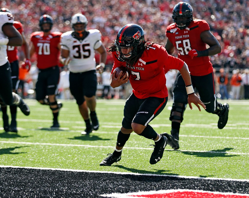 Texas Tech's Jett Duffey (7) scores a touchdown during the game against Oklahoma State, Saturday, Oct. 5, 2019, in Lubbock, Texas. (AP Photo/Brad Tollefson)