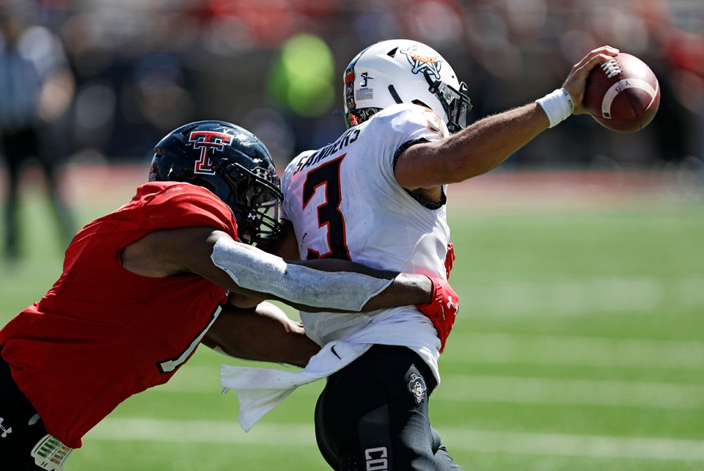 Texas Tech's Jordyn Brooks (1) sacks Oklahoma State's Spencer Sanders (3) during the game Saturday, Oct. 5, 2019, in Lubbock, Texas. (AP Photo/Brad Tollefson)