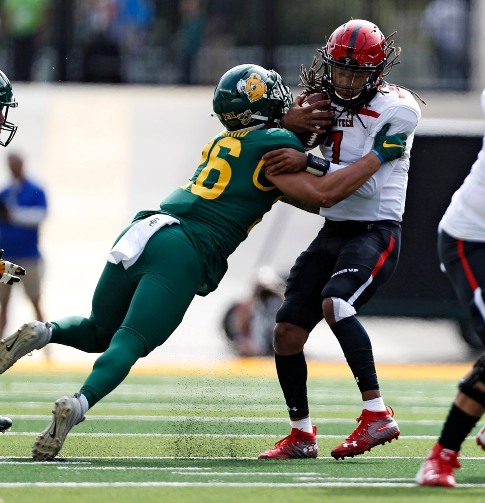 Baylor's Terrel Bernard (26) sacks Texas Tech's Jett Duffey (7) during the game Saturday, Oct. 12, 2019, at McLane Stadium in Waco, Texas. [Brad Tollefson/A-J Media]