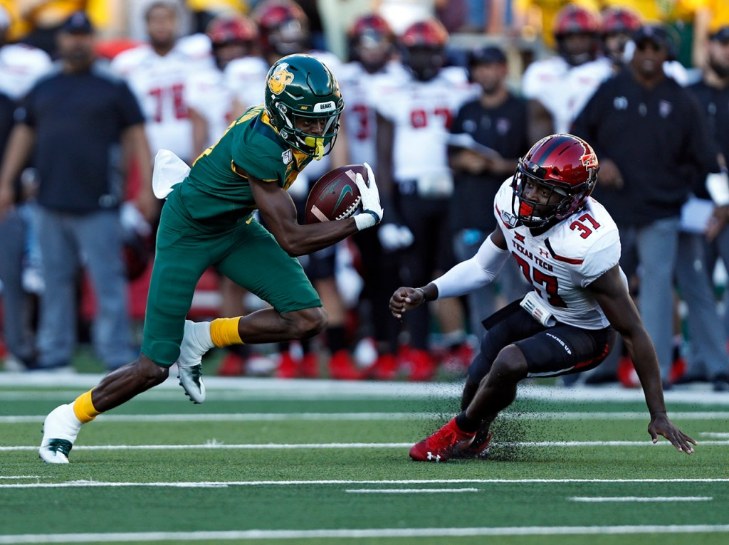 Baylor's Tyquan Thornton (81) breaks away from Texas Tech's Xavier Benson (37) during the game Saturday, Oct. 12, 2019, at McLane Stadium in Waco, Texas. [Brad Tollefson/A-J Media]