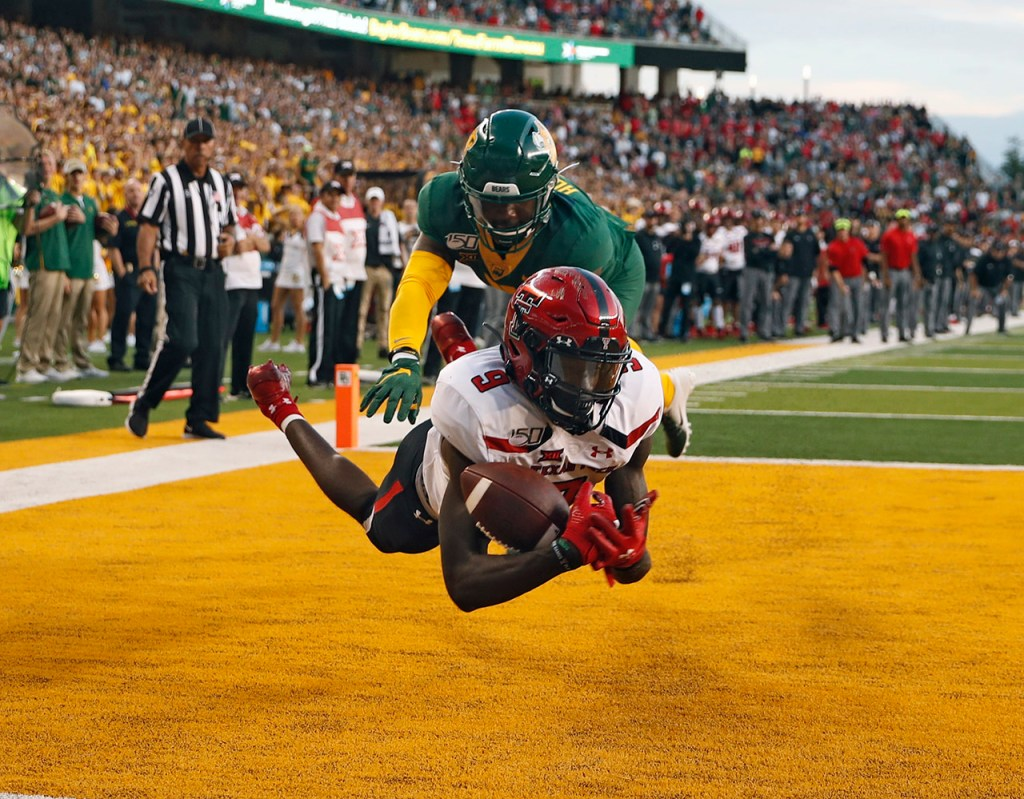 Texas Tech's T.J. Vasher (9) scores a touchdown around Baylor's Jameson Houston (11) in overtime during the game Saturday, Oct. 12, 2019, at McLane Stadium in Waco, Texas. [Brad Tollefson/A-J Media]
