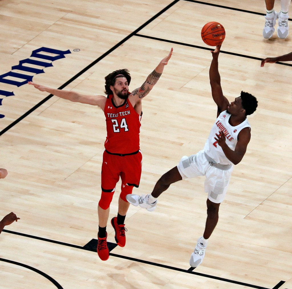 Louisville's Darius Perry (2) shoots the ball over Texas Tech's Avery Benson (24) during the first half of the Jimmy V Classic game Tuesday, Dec. 10, 2019, at Madison Square Garden in New York, N.Y. [Brad Tollefson/A-J Media]