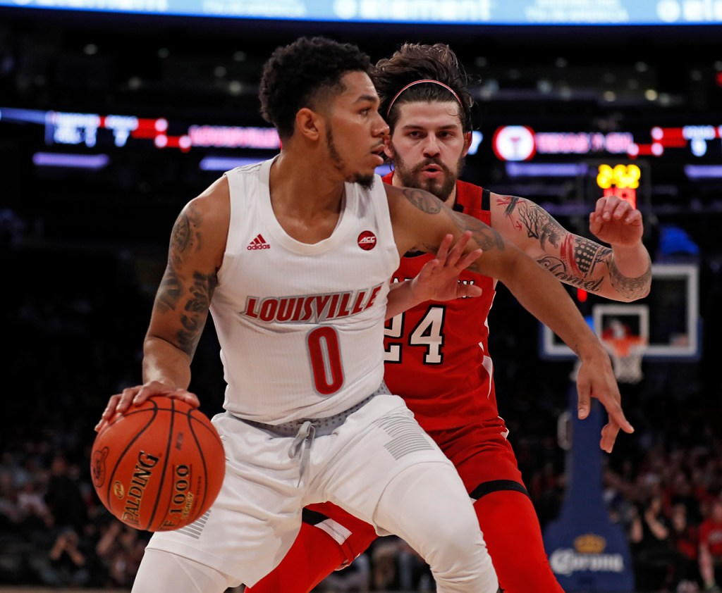 Texas Tech's Avery Benson (24) defends Louisville's Lamarr Kimble (0) during the first half of the Jimmy V Classic game Tuesday, Dec. 10, 2019, at Madison Square Garden in New York, N.Y. [Brad Tollefson/A-J Media]