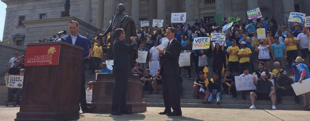Matt Moore, Sen. Tom Davis and Rep. James Smith in front of the rally crowd.