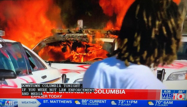 A police car burns in downtown Columbia.