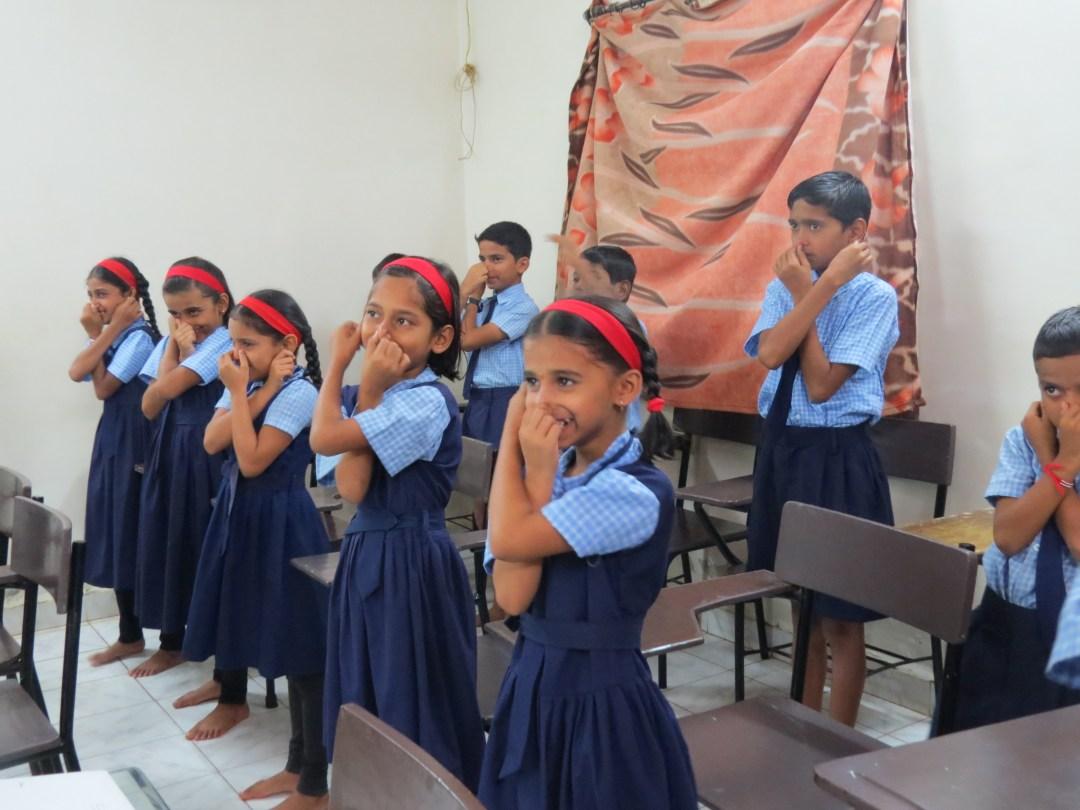 Little girls doing Brain Gym movement