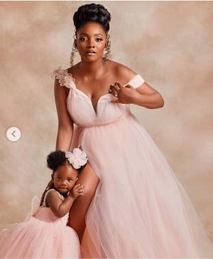 Adekunle Gold, Simi Shows Off Their Baby's Face