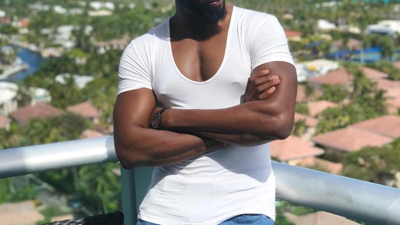 Actor Gbenro Ajibade flashes his nipples nipple rings and rainbow sign