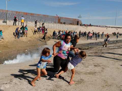Women And Children Flees As U.S. Officers Fire Teargas At Migrant Caravan