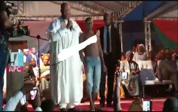 Boy Places Shirt For Senator Akpabio To Walk On, Gets N500K To Buy New One