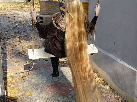 Lady Shows Off Her Long Hair After Staying For 28 Year Without Cutting It
