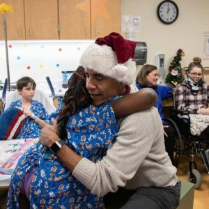 Obama Surprises Hospital Patients With Christmas Presents