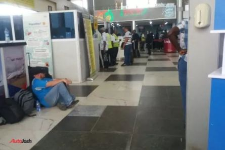 Foreigners Sit On The Floor At The Airport In Lagos