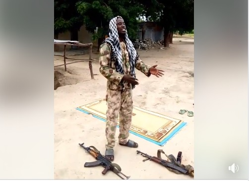 Scholar Preaches To Soldiers With Two AK-47 Rifles By His Side