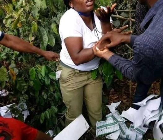 Corps Member Caught In The Bush Destroying Ballot Papers In Imo State