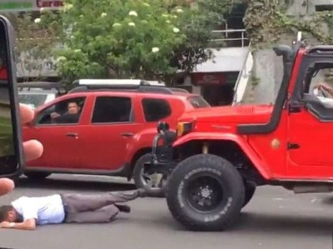 Shocking Moment Man Driving Jeep Ran Over A Bus Driver Following A Traffic Accident