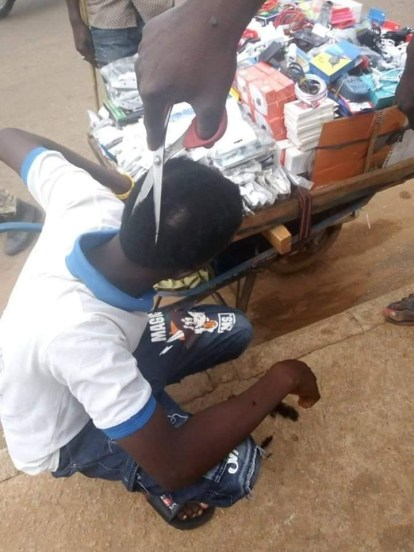 Niger State: Taskforce Forcefully Shave Young Men's Hair With Scissor