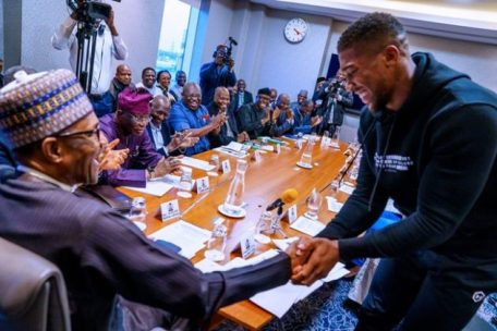 Anthony Joshua Presents Heavyweight Titles To President Buhari In UK, As He Prostrate