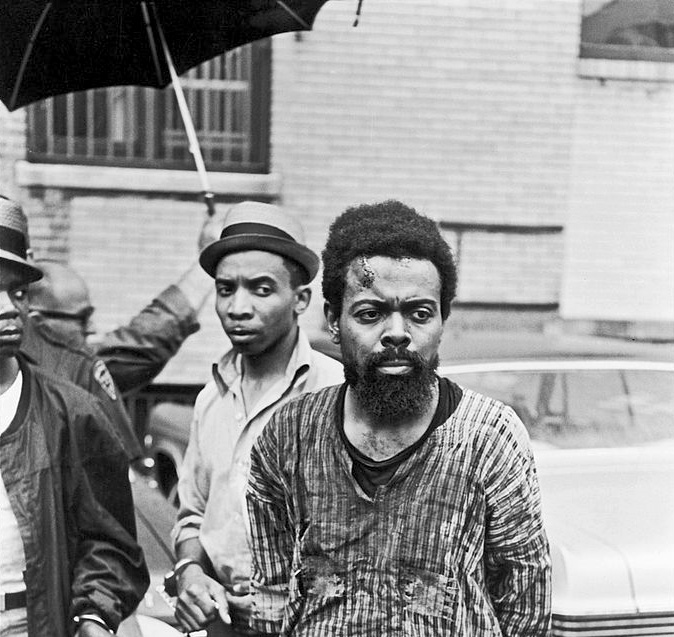 Baraka, with a visible wound on his forehead, after his arrest (Photograph: Fred W. McDarrah / Getty)