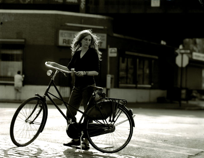 Patti Smith with her bicycle, New York City, 1999. (Photograph: Steven Sebring)