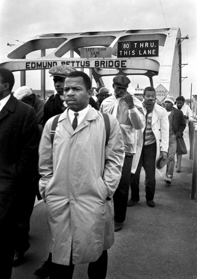 John Lewis leads peaceful marchers across the Edmund Pettus Bridge, Selma, Alabama, 1965