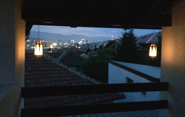 View of the Sarajevo skyline at night, from the third-floor balcony of our home.