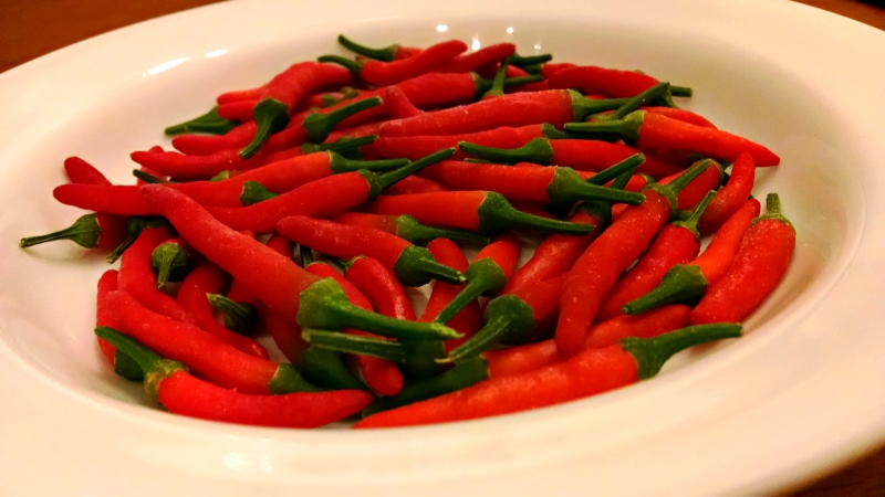 [image: somewhere in the range of 40–50 red chile peppers]