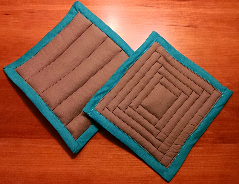 [image: two homemade potholders]