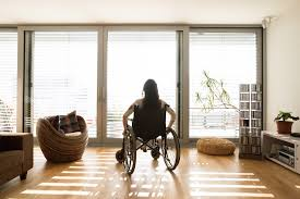 Young-woman-in-wheelchair-staring-out