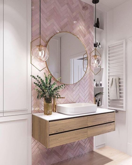 Pink bathroom tiles and free standing sink