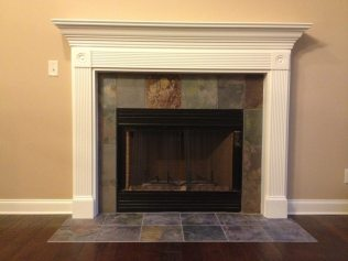 New home custom fireplace mantle with slate surround