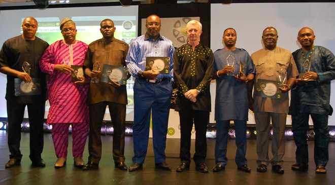Chief Executive Officer, Etisalat Nigeria, Mr. Steven Evans (4th from right) with some of the winners at the Etisalat Heroes Awards 2012