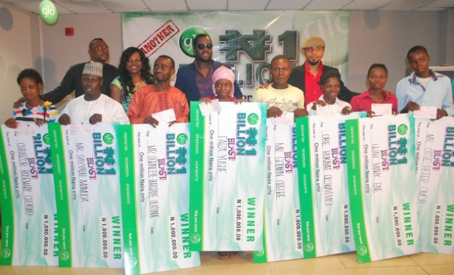 A cross section of the winners posing with Glo ambassadors Odunlade Adekola, Funke Akindele, Desmond Elliot and Ramsey Nouah at the cheque presentation ceremony held recently in Lagos.