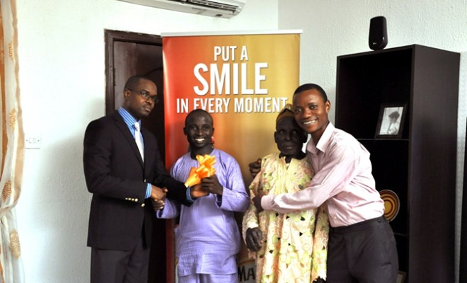 L-R: Marketing Manager, Non-Alcholic, NB Plc, Mr. Tokunbo Adodo presenting the house key to Mr. Oluwashola Akinsanya, a winner with the father Pa. Taiwo Akinsanya and Yomi Oyelano, during the presentation of the Maltina House in Lagos over the weekend