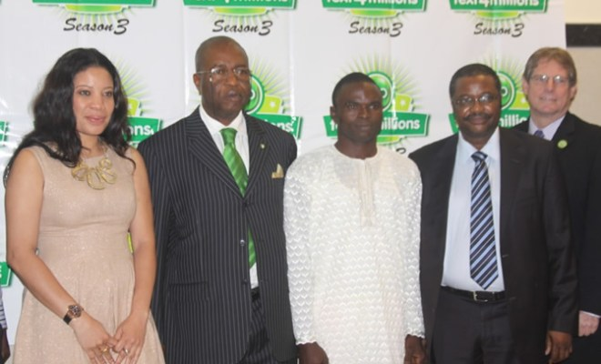 """Globacom's Acting Head of Marketing, Niyi Olukoya, (second right), Mike Sidwell, Retail Sales Director (right), Glo Ambassador, Monalisa Chinda (left), Assistant Director, National Lottery Regulatory Commission (NLRC), Obi Iregbu and winner of N10 million in Season 2, Olugbenga Adebola at the launch of Season 3 of the Glo """"text4millions"""" promo held in Lagos"""