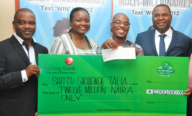 "Globacom's Head of Value Added Services, Samson Isa (right), presenting a cheque of N12 million to Shittu Shodeinde Talia, the first monthly prize winner in the Glo ""text4millions"" promo at a special ceremony held at Globacom's corporate headquarters in Lagos on Wednesday. With them are Head of Distribution, Glozones and Branding, Dapo Dosunmu and Head, Sales Development, Shade Olusope."