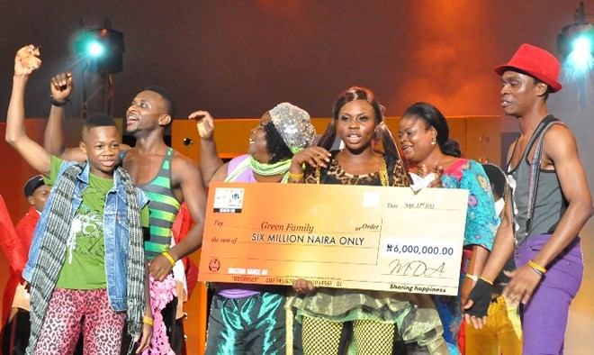 Mrs Adejoke Orelope-Adefulire, Deputy Governor of Lagos State presenting a cheque of N6 million to the Green Family winners of Maltina Dance All 6 held at Eko Hotel and Suites in Lagos