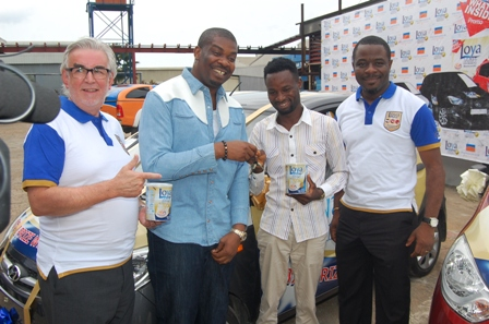 Managing Director, Promasidor Nigeria, Chief Keith Richards, Brand Ambassador Loya Milk, Michael Ajereh 'Don Jazzy' presenting a brand new Hyundai i10AT car to winner Abereoje Sunday and Commercial Director, Promasidor, Kachi Onubogu