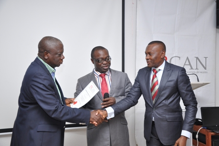 Emeka Maduegbuna, Former PRCAN President Congratulating Desmond Ekeh, CEO Synthesis Communications, (middle) is PRCAN President, Chido Nwakama