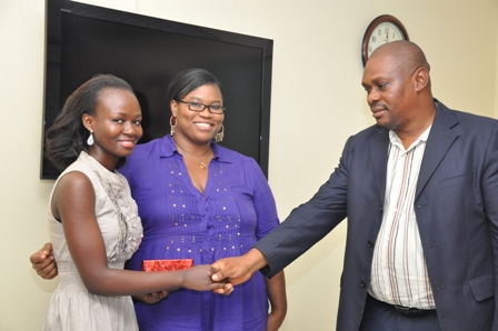 Star Prize winner, Hannah Ojo from University of Ife receiving her gift from the Editor of BrandiQ, Usukuma Ntia
