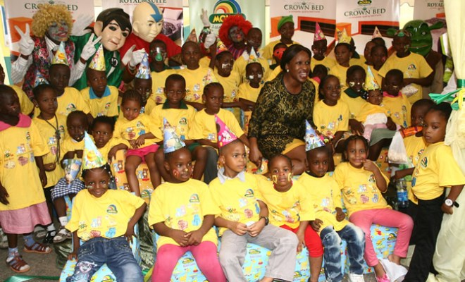 Managing Director, Mouka Limited, Peju Adebajo (middle), with some pupils at Mouka Baby Range Product Launch while celebrating Children's Day at Mouka Head Office in Lagos, on May 27th, 2013