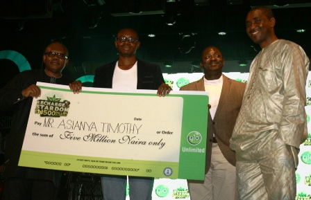 "The winner of N5million in the ongoing Glo ""Recharge to Stardom"" promo, Timothy Asianya (second left) collecting his cheque from the Lagos state Commissioner for Tourism and Inter-Governmental Affairs, Hon. Disun Holloway, Senior Manager, Compliance, Monitoring and Enforcement of the NCC, Lawrence Abang and the Assistant Director, National Lottery Regulatory Commission, Fidelis Ajibogun during the prize presentation ceremony held on Saturday in Lagos."