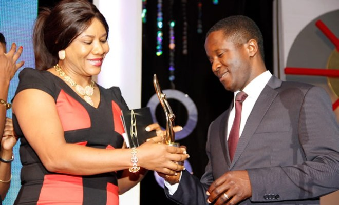 (From the right) Head of Project, British American Tobacco Nigeria Foundation (BATNF), Mr. Abayomi Oyewole being presented with an award of most outstanding CSR practitioner by the CEO, BrandWorld Newspapers, Clara Okoro, during the 7th annual SERA Awards held on Saturday September 21, 2013 at the Muson Center, Lagos.