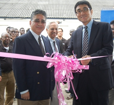 Chairman Flying Dove Limited, Karan Israni and the Managing Director Sony Middle East and Africa, Hiroyusa Sugiyama cutting the tape to open the new Sony service centre in Lagos.